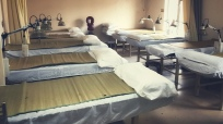 typical acupuncture treatment room with 10 beds